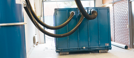 Central vacuum system connected to a container